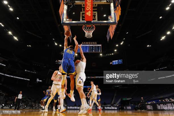 Stephen Curry of the Golden State Warriors drives to the basket during the game against the Denver Nuggets on April 12, 2021 at Chase Center in San...