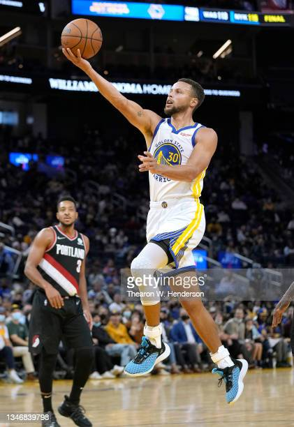 Stephen Curry of the Golden State Warriors drives to the basket against the Portland Trail Blazers during the second half of their game at Chase...