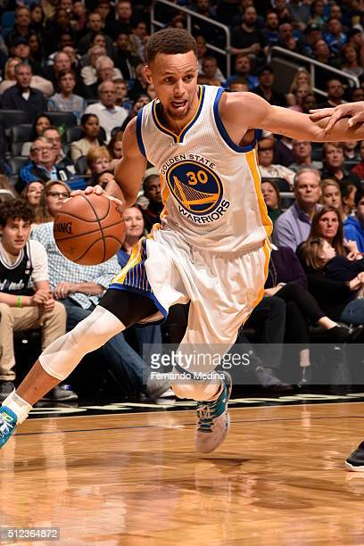 Stephen Curry of the Golden State Warriors drives to the basket against the Orlando Magic on February 25 2016 at Amway Center in Orlando Florida NOTE...
