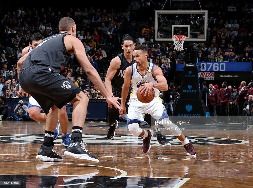 Stephen Curry #30 of the Golden State Warriors drives to the basket against the Brooklyn Nets on December 22, 2016 at Barclays Center in Brooklyn, NY.