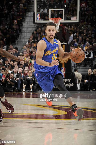 Stephen Curry of the Golden State Warriors drives to the basket against the Cleveland Cavaliers during the game on December 25 2016 at Quicken Loans...