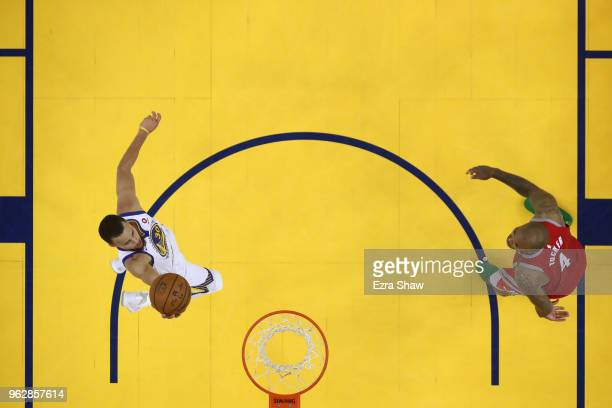 Stephen Curry of the Golden State Warriors drives to the hoop against the Houston Rockets during Game Six of the Western Conference Finals in the...