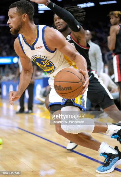 Stephen Curry of the Golden State Warriors drives towards the basket against the Portland Trail Blazers during the second half of their game at Chase...