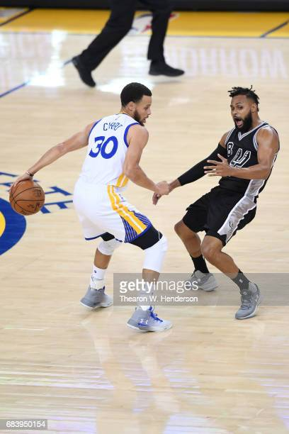 Stephen Curry of the Golden State Warriors drives with the ball against Patty Mills of the San Antonio Spurs during Game Two of the NBA Western...
