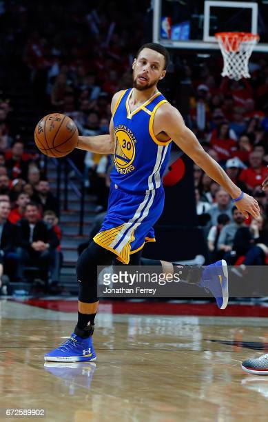 Stephen Curry of the Golden State Warriors drives with the ball over against the Portland Trail Blazers during Game Three of the Western Conference...