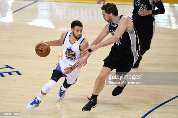 Stephen Curry of the Golden State Warriors drives with the ball against Pau Gasol of the San Antonio Spurs during Game Two of the NBA Western...