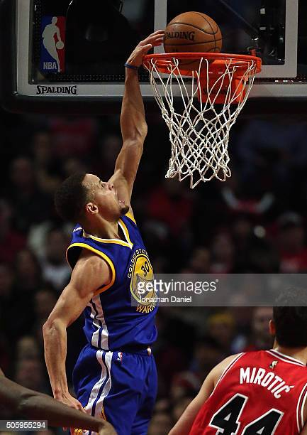 Stephen Curry of the Golden State Warriors dunks against the Chicago Bulls at the United Center on January 20 2016 in Chicago Illinois The Warriors...
