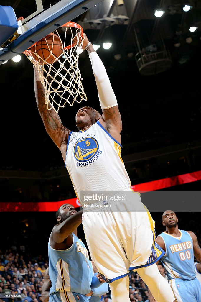 Stephen Curry #30 of the Golden State Warriors dunks against the Denver Nuggets on January 19, 2015 at Oracle Arena in Oakland, California.