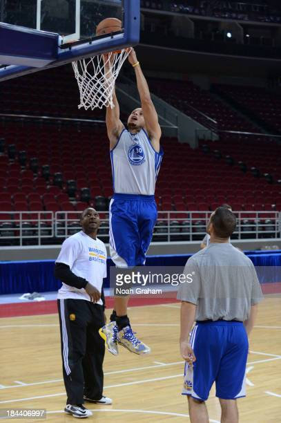 Stephen Curry of the Golden State Warriors dunks during practice as part of 2013 Global Games on October 13 2013 at the MasterCard Center in Beijing...