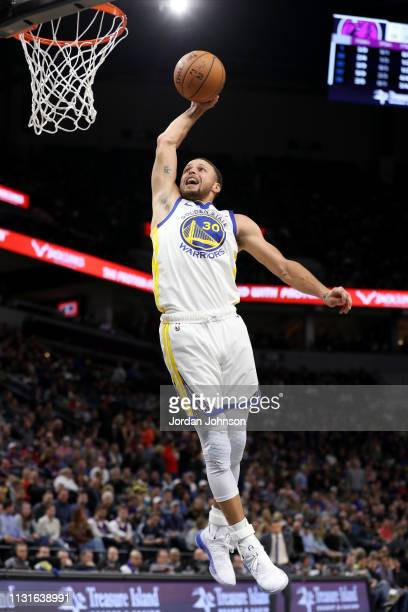Stephen Curry of the Golden State Warriors dunks the ball against the Minnesota Timberwolves on March 19 2019 at Target Center in Minneapolis...