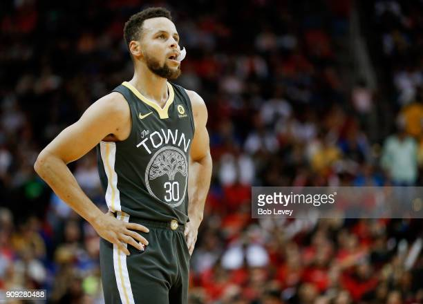 Stephen Curry of the Golden State Warriors during game action against the Houston Rockets at Toyota Center on January 20 2018 in Houston Texas NOTE...