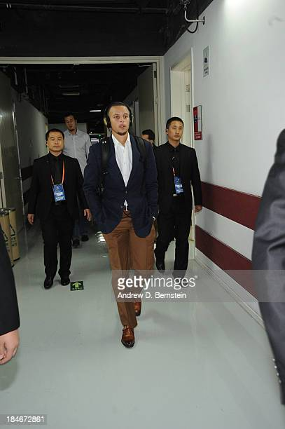 Stephen Curry of the Golden State Warriors enters the arena for the game against the Los Angeles Lakers during the 2013 Global Games on October 15...