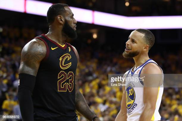 Stephen Curry of the Golden State Warriors exchanges words with LeBron James of the Cleveland Cavaliers in overtime during Game 1 of the 2018 NBA...
