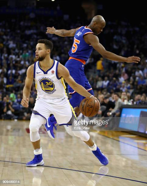 Stephen Curry of the Golden State Warriors fakes out Jarrett Jack of the New York Knicks at ORACLE Arena on January 23 2018 in Oakland California...