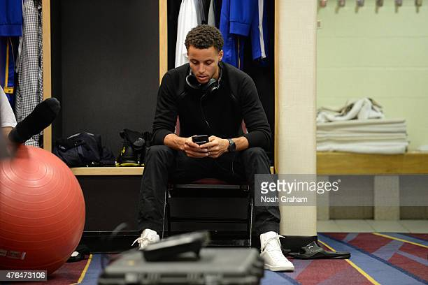 Stephen Curry of the Golden State Warriors gets ready in the locker room before a game against the Cleveland Cavaliers in Game Three of the 2015 NBA...