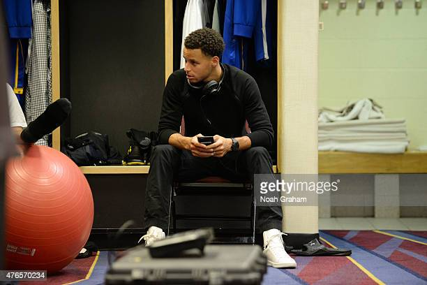 Stephen Curry of the Golden State Warriors gets ready in the locker room before a game against the Cleveland Cavaliers during Game Three of the 2015...