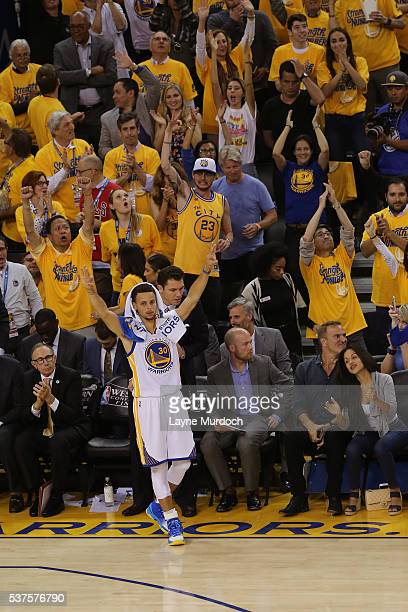 Stephen Curry of the Golden State Warriors gets the crowd into in Game Five of the Western Conference Finals against the Oklahoma City Thunder during...
