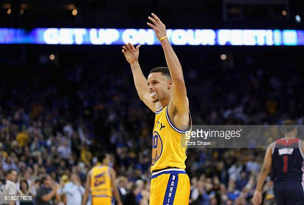 Stephen Curry of the Golden State Warriors gets the crowd louder during their game against the Washington Wizards at ORACLE Arena on March 29 2016 in...
