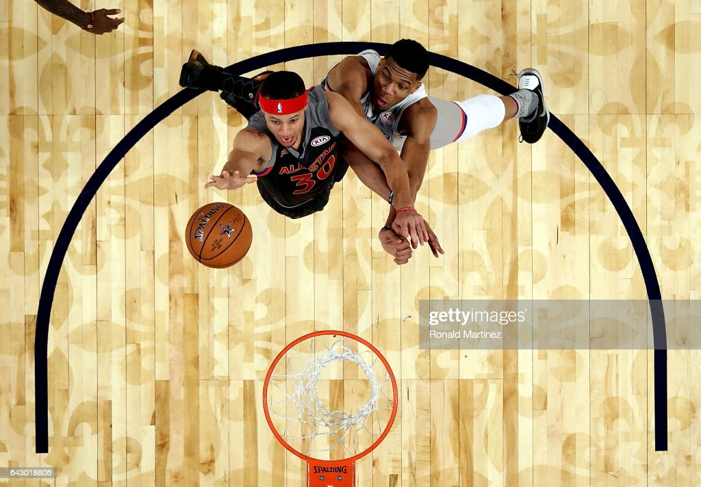 Stephen Curry #30 of the Golden State Warriors goes for a slam dunk against Giannis Antetokounmpo #34 of the Milwaukee Bucks during 2017 NBA All-Star Game at Smoothie King Center on February 19, 2017 in New Orleans, Louisiana.