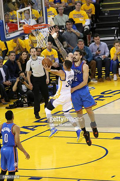 Stephen Curry of the Golden State Warriors goes for the layup during the game against Steven Adams of the Oklahoma City Thunder in Game Two of the...