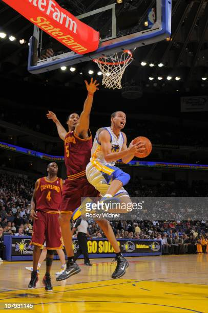 Stephen Curry of the Golden State Warriors goes for the reverse layup against the Cleveland Cavaliers on January 7 2011 at Oracle Arena in Oakland...