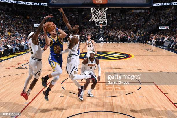 Stephen Curry of the Golden State Warriors goes to the basket against the Denver Nuggets on January 15 2019 at the Pepsi Center in Denver Colorado...