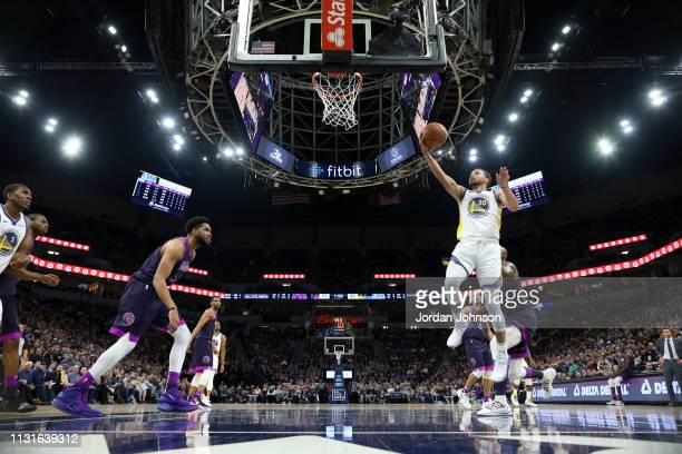 Stephen Curry of the Golden State Warriors goes to the basket against the Minnesota Timberwolves on March 19 2019 at Target Center in Minneapolis...