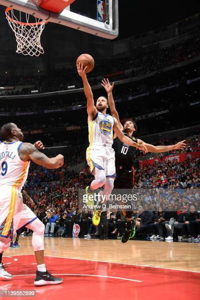 Stephen Curry of the Golden State Warriors goes to the basket against the LA Clippers during Game Six of Round One of the 2019 NBA Playoffs on April...