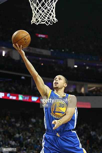Stephen Curry of the Golden State Warriors goes to the basket against the Los Angeles Lakers during the 2013 Global Games at the MercedesBenz Arena...