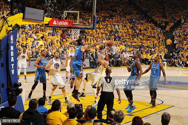 Stephen Curry of the Golden State Warriors goes to the basket against Steven Adams of the Oklahoma City Thunder in Game One of the Western Conference...