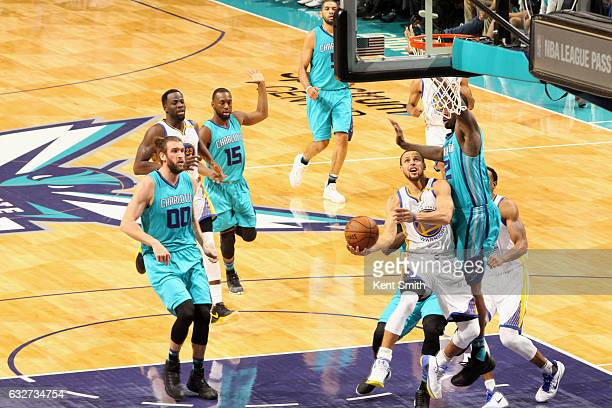 Stephen Curry of the Golden State Warriors goes to the basket against the Charlotte Hornets on January 25 2017 at Spectrum Center in Charlotte North...