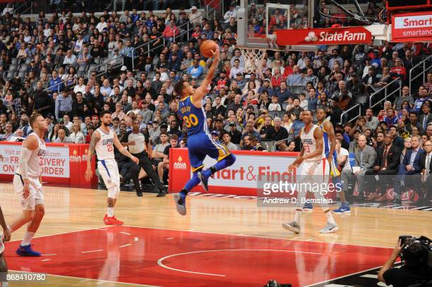 Stephen Curry of the Golden State Warriors goes to the basket against the LA Clippers on October 30 2017 at STAPLES Center in Los Angeles California...