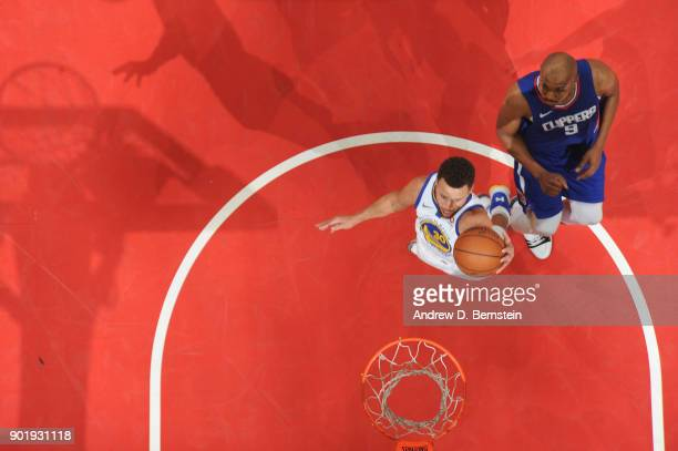 Stephen Curry of the Golden State Warriors goes to the basket against the LA Clippers on January 6 2018 at STAPLES Center in Los Angeles California...