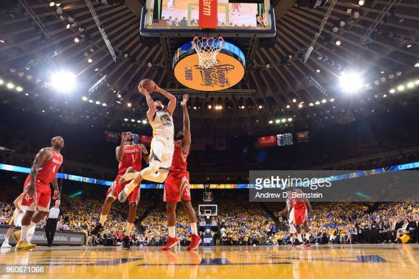 Stephen Curry of the Golden State Warriors goes to the basket against the Houston Rockets during Game Three of the Western Conference Finals during...