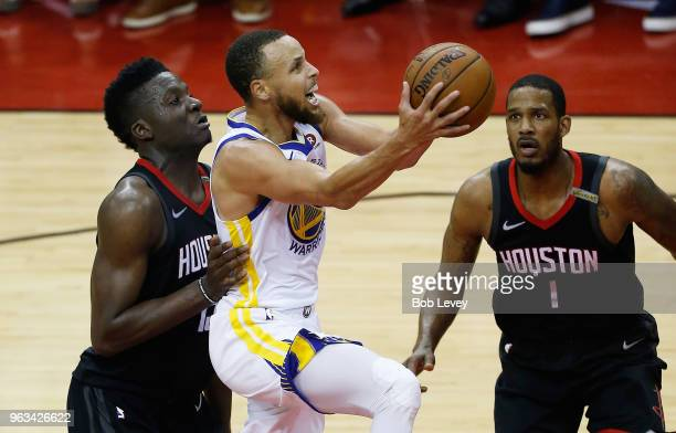 Stephen Curry of the Golden State Warriors goes up against Clint Capela and Trevor Ariza of the Houston Rockets in the second quarter of Game Seven...