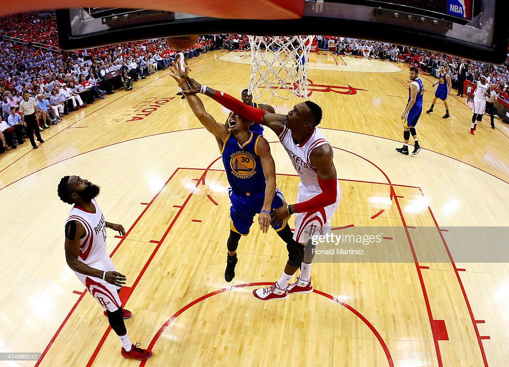 Stephen Curry #30 of the Golden State Warriors goes up against Dwight Howard #12 of the Houston Rockets in the first half during Game Three of the Western Conference Finals of the 2015 NBA PLayoffs at Toyota Center on May 23, 2015 in Houston, Texas.