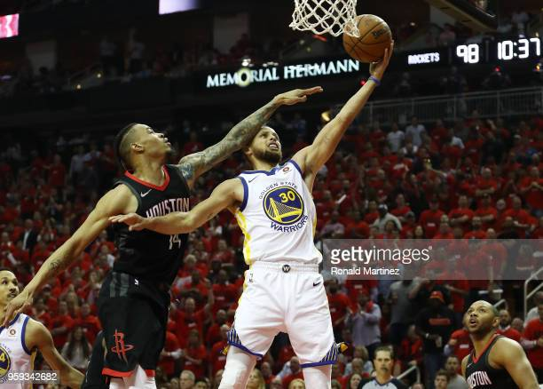 Stephen Curry of the Golden State Warriors goes up against Gerald Green of the Houston Rockets in the second half of Game Two of the Western...
