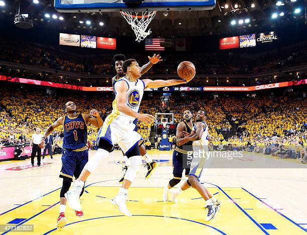 Stephen Curry of the Golden State Warriors goes up against Iman Shumpert of the Cleveland Cavaliers in the second quarter during Game Five of the...