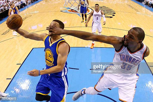 Stephen Curry of the Golden State Warriors goes up against Kevin Durant of the Oklahoma City Thunder in the second half in game four of the Western...