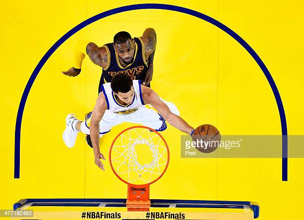 Stephen Curry of the Golden State Warriors goes up against LeBron James of the Cleveland Cavaliers in the first half during Game Five of the 2015 NBA...