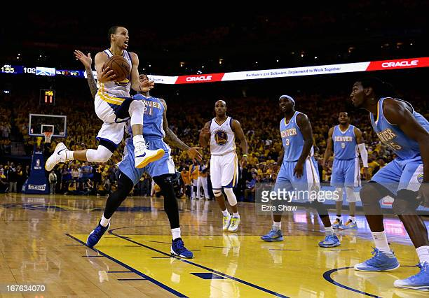 Stephen Curry of the Golden State Warriors goes up for a shot against the Denver Nuggets during Game Three of the Western Conference Quarterfinals of...