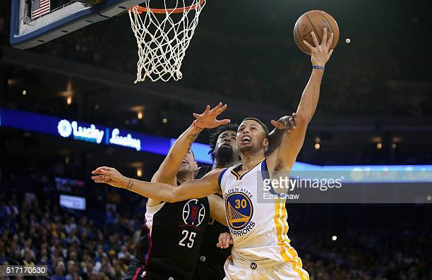 Stephen Curry of the Golden State Warriors goes up for a shot against Austin Rivers and DeAndre Jordan of the Los Angeles Clippers at ORACLE Arena on...