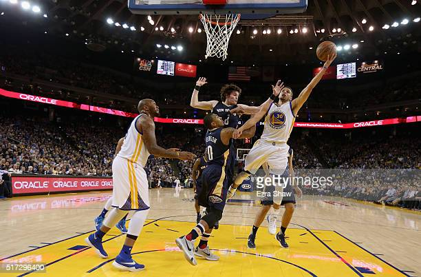 Stephen Curry of the Golden State Warriors goes up for a shot against the New Orleans Pelicans at ORACLE Arena on March 14 2016 in Oakland California...
