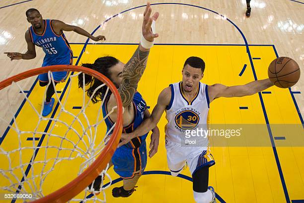 Stephen Curry of the Golden State Warriors goes up for a shot against Steven Adams of the Oklahoma City Thunder during game two of the Western...
