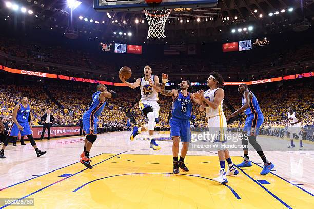 Stephen Curry of the Golden State Warriors goes up for a shot against the Oklahoma City Thunder during game two of the Western Conference Finals...