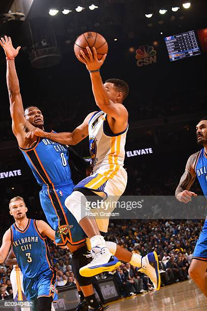 Stephen Curry of the Golden State Warriors goes up for a shot against Russell Westbrook of the Oklahoma City Thunder during a game on November 3 2016...