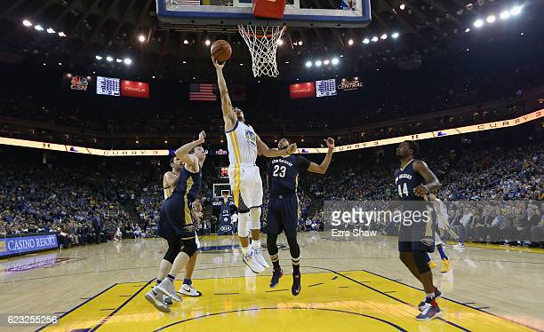 Stephen Curry of the Golden State Warriors goes up for a shot against Anthony Davis of the New Orleans Pelicans at ORACLE Arena on November 7 2016 in...