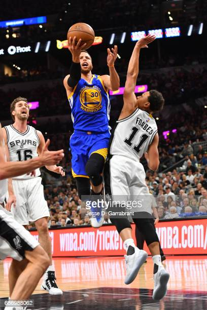 Stephen Curry of the Golden State Warriors goes up for a shot against the San Antonio Spurs during Game Four of the Western Conference Finals of the...