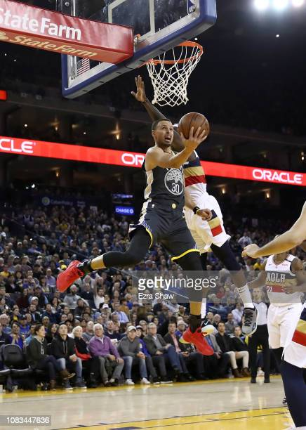 Stephen Curry of the Golden State Warriors goes up for a shot on Jrue Holiday of the New Orleans Pelicans at ORACLE Arena on January 16 2019 in...