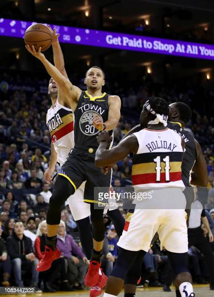 Stephen Curry of the Golden State Warriors goes up for a shot on Nikola Mirotic of the New Orleans Pelicans at ORACLE Arena on January 16 2019 in...